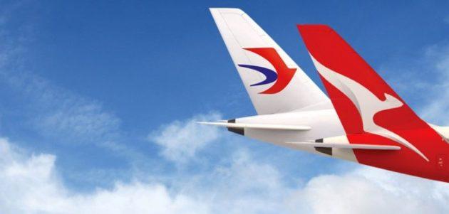 QantasChinaEasternTails-702x336.jpg